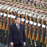 Председатель КНР Си Цзиньпин (слева) и президент Филиппин Родриго в Пекине, Китай (Фото: AP Photo/TASS)